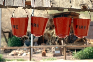 Fire buckets hang over the well in the town center of the 1890's Silver town of Calico. Calico has burned to the ground twice in its history